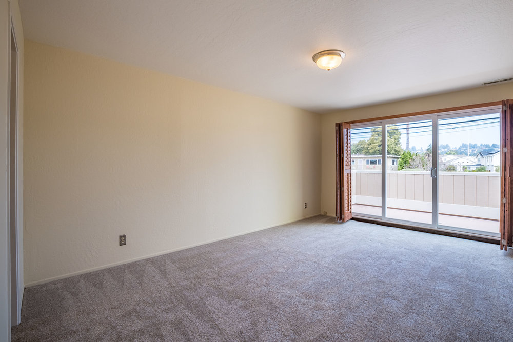 Spacious Bedroom with Natural Light Real Estate Offices in Santa