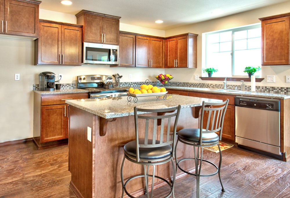 This kitchen in our model home at TRIO features one of the three standard finishes included with every home offered in our Cottages collection.