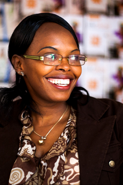 "Lilian Mungai - Branch Manager Kawangware, Nairobi ""When I discovered LivelyHoods I was doing part-time classes in sales and marketing, and came across the training advert in the newspaper. I passed the interview, and became a sales agent, which I did for six months before working as a branch manager. I have now also trained other branch managers who have been promoted, like me. I first thought I couldn't sell, but after going through the training I made the decision to at least try it out, though I had to work on my confidence. When I was able to overcome this, I was able to motivate people, help other agents in facing some of their challenges, and change people's lives on a daily basis. I truly love working in the community, and I now have the confidence to do it. Being a part of the change at LivelyHoods and contributing to the organization's goals, whilst also achieving my own goals, is something I'm very proud of."