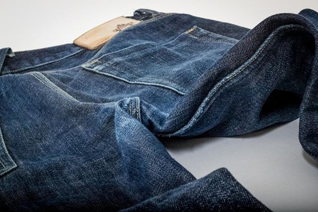 Close your eyes, picture the scene. It's Christmas day. Your loved ones have bought you some brand new FD001 14 oz Red Selvedge and you're over the moon. They're raw, they feel stiff, you can't wait to break them in. You run upstairs to try them on, you decide you'll break them in straight away, screw that Christmas Day outfit that is already laid out on your bed. These are better. Fast forward 6 months, you've been on holiday to Sweden in your FD001s, you've been to Filey too and they soaked up that British sun, you've had a fair few meals out in them and you're unsure if that mark on the right thigh was always there, or if it's your vegetable achari balti. You don't care. Your jeans are becoming yours. The bottom line is that they're fading, they're fading very nicely indeed. So nice in fact that you get comments on them from fellow denim connoisseurs, you don't even care if you only have one other friend interested enough in denim that you call them a connoisseur. You bask in that glory. Now a huge moment comes. You wash them, for the first time. You're eager to see how they look. You sit by the washing machine with your fingers crossed. You wonder if you wore your wallet enough. Doubt sets in. No, you shift that doubt. You're confident. You've had compliments after all. Okay, open your eyes.  This is how they look. 'Bloody brilliant' you think, correctly. . . . #ForgeDenim #MadeinEngland #EveryDetailMatters