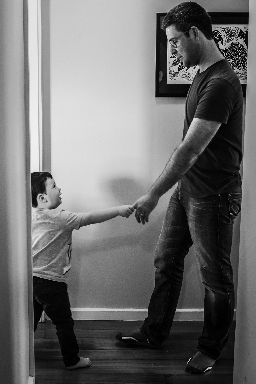 Father and son hand in hand during newborn photography session Bayside Melbourne