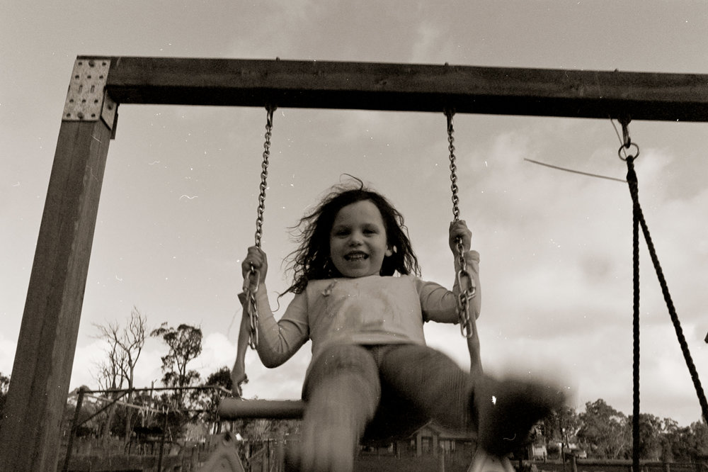 child on swings during lifestyle photography session at location in Warragul. Shot on film
