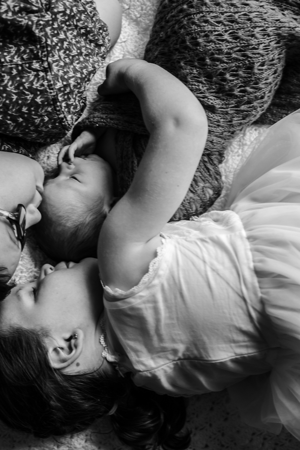 sibling cuddles during in home lifestyle family photography session at home location in Mornington