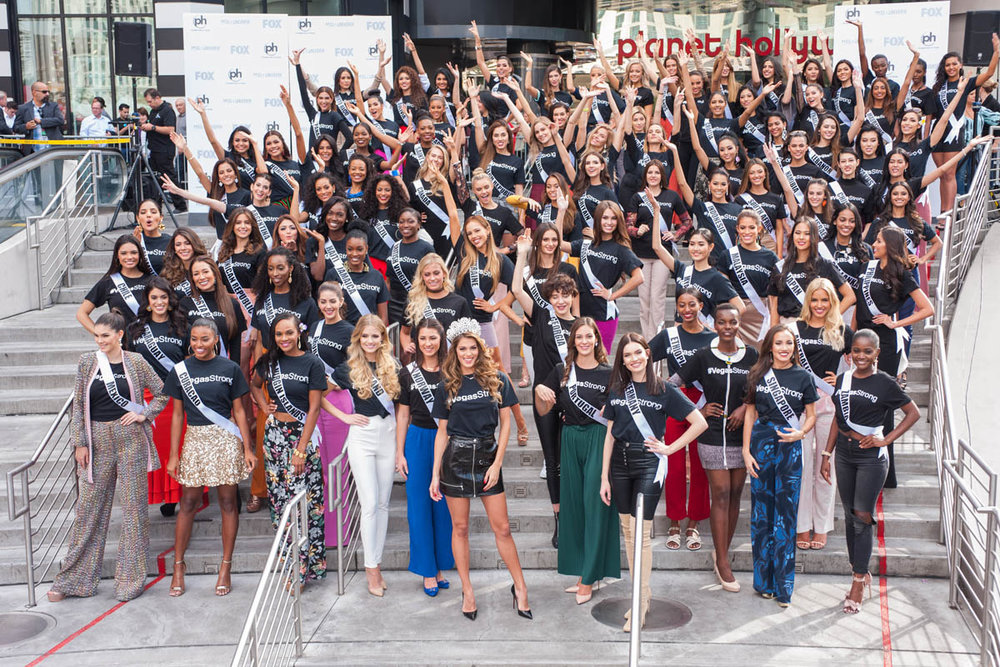 Iris Mittenaere poses with the 92 contestants of the 66th Miss Universe Pageant at Miracle Mile Shops in Las Vegas on Thursday, November 16th, 2017