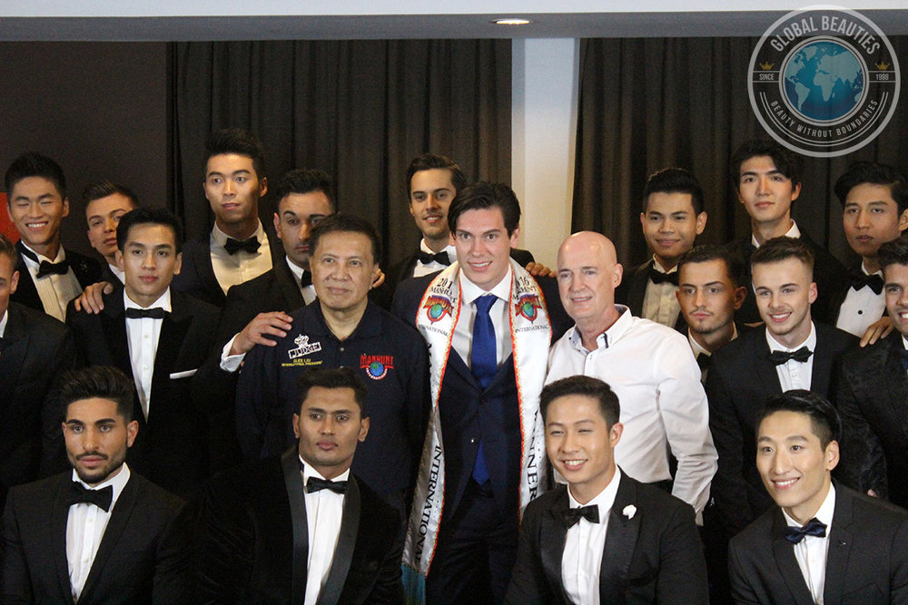 Manhunt International 2017 contestants with International President Alex Liu (L) and Executive President Rosko Dickinson (R) who have been in charge of the competition since 1993.