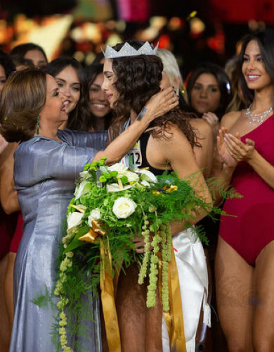 The new Miss Italia cries as she receives her sash and crown!
