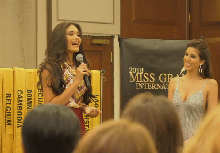 A happy Miss Venezuela introduces herself during the sash ceremony.
