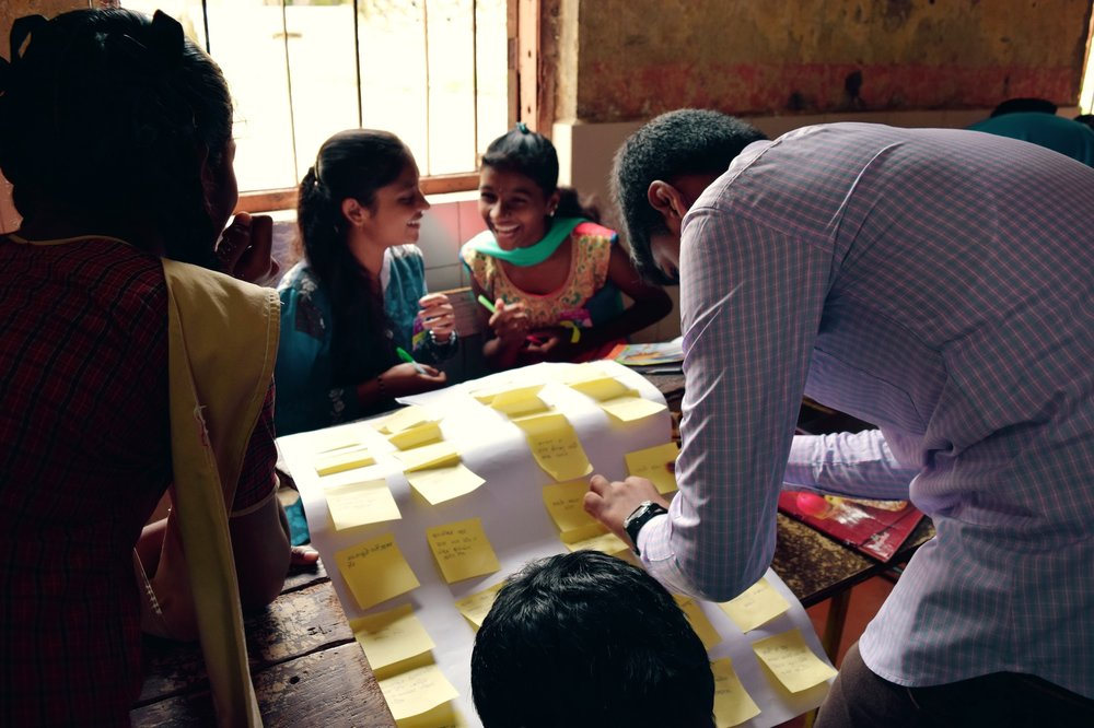 School students from a Mumbai slum participating in a problem solving workshop organized by Ycenter. The kids solved local problems, using human centered design methods, and implemented small scale pilots in their neighborhoods