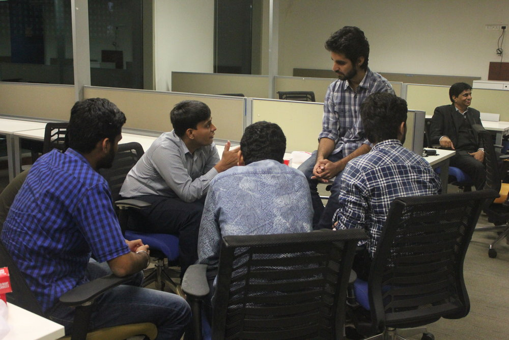 Participants in the last India's Next 40 program giving feedback to each other.