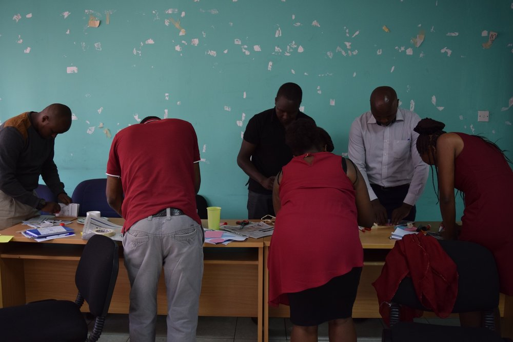 A group pf participants working on an activity during our Social Entrepreneurship for Agriculture program in Kenya