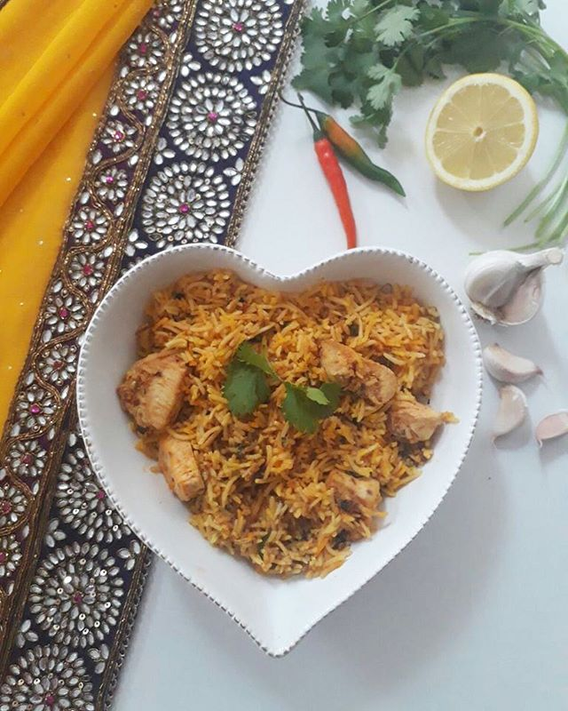 Presenting Julie's timeless Chicken Biriyani; Boneless chicken pieces are marinated in exotic spices such as saffron overnight before it is cooked in yoghurt. The cooked meat is then layered between long-grained basmati rice and baked in the oven. Served with spiced dhal infused with cardamon..... WOW! 💥