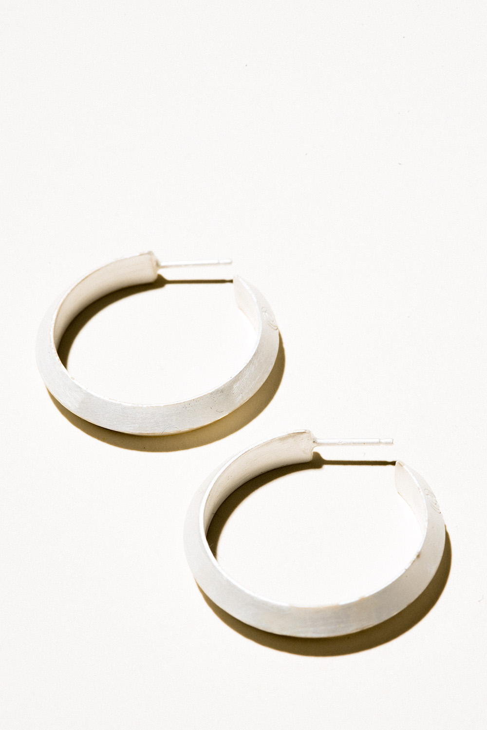 Medium Prism Hoops - 30mm diameterSterling Silver, Raw FinishHand Smithed $200