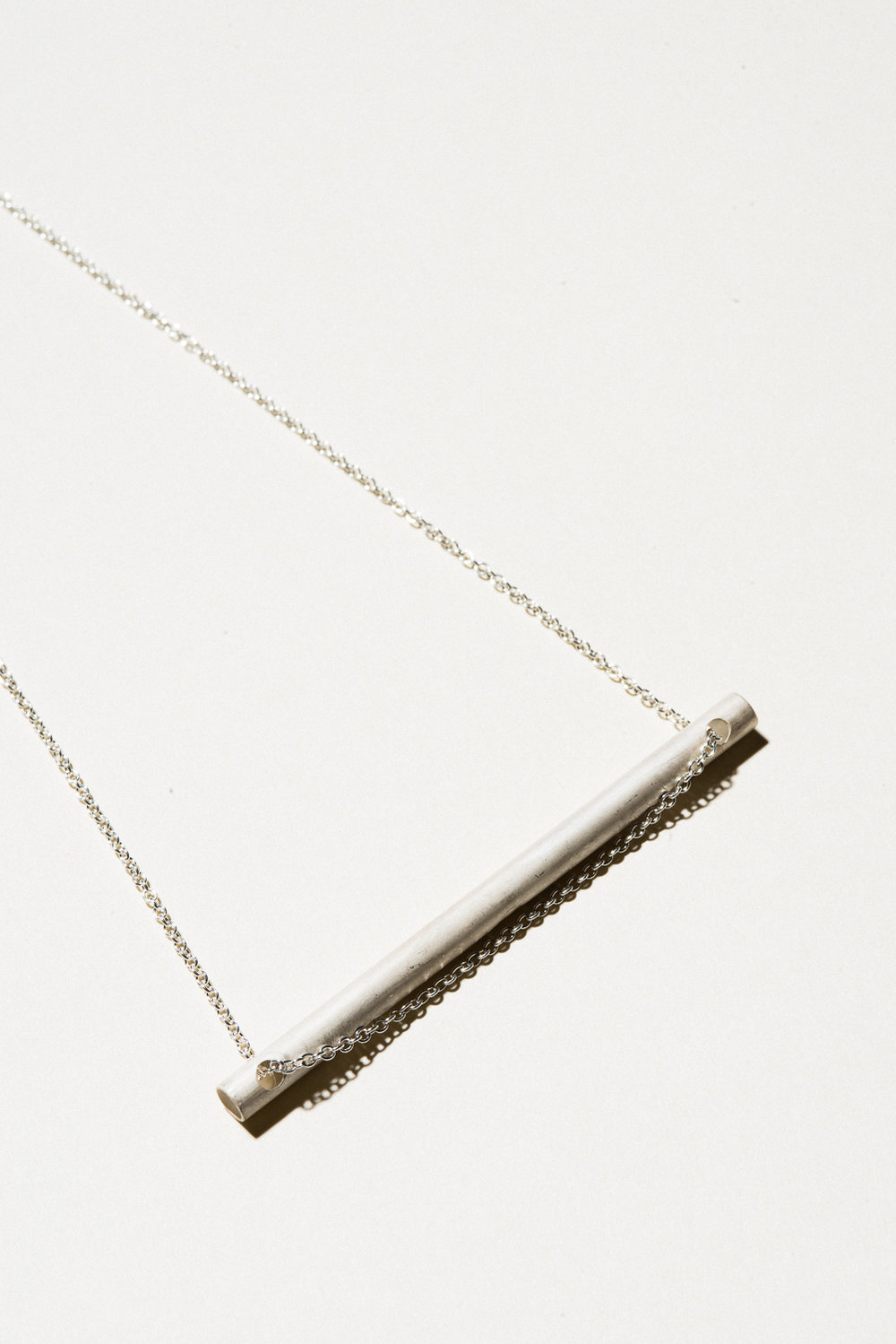 "Silver Straw Necklace - 3"" on a 22"" chainSterling Silver, Raw FinishHand Smithed$100"
