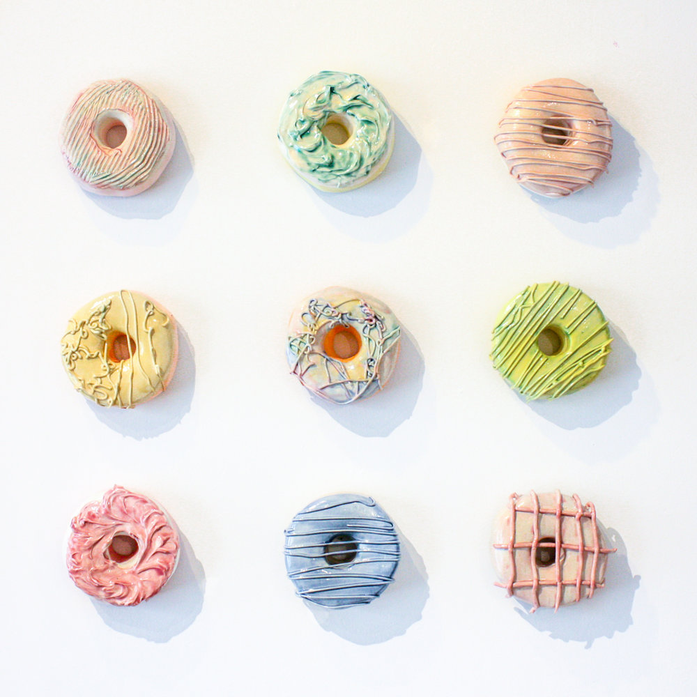 """Pastel Goo Donut Set - Nine 5"""" x 5"""" donuts, 18"""" x 18""""Stoneware clay and ceramic glazeSOLD"""
