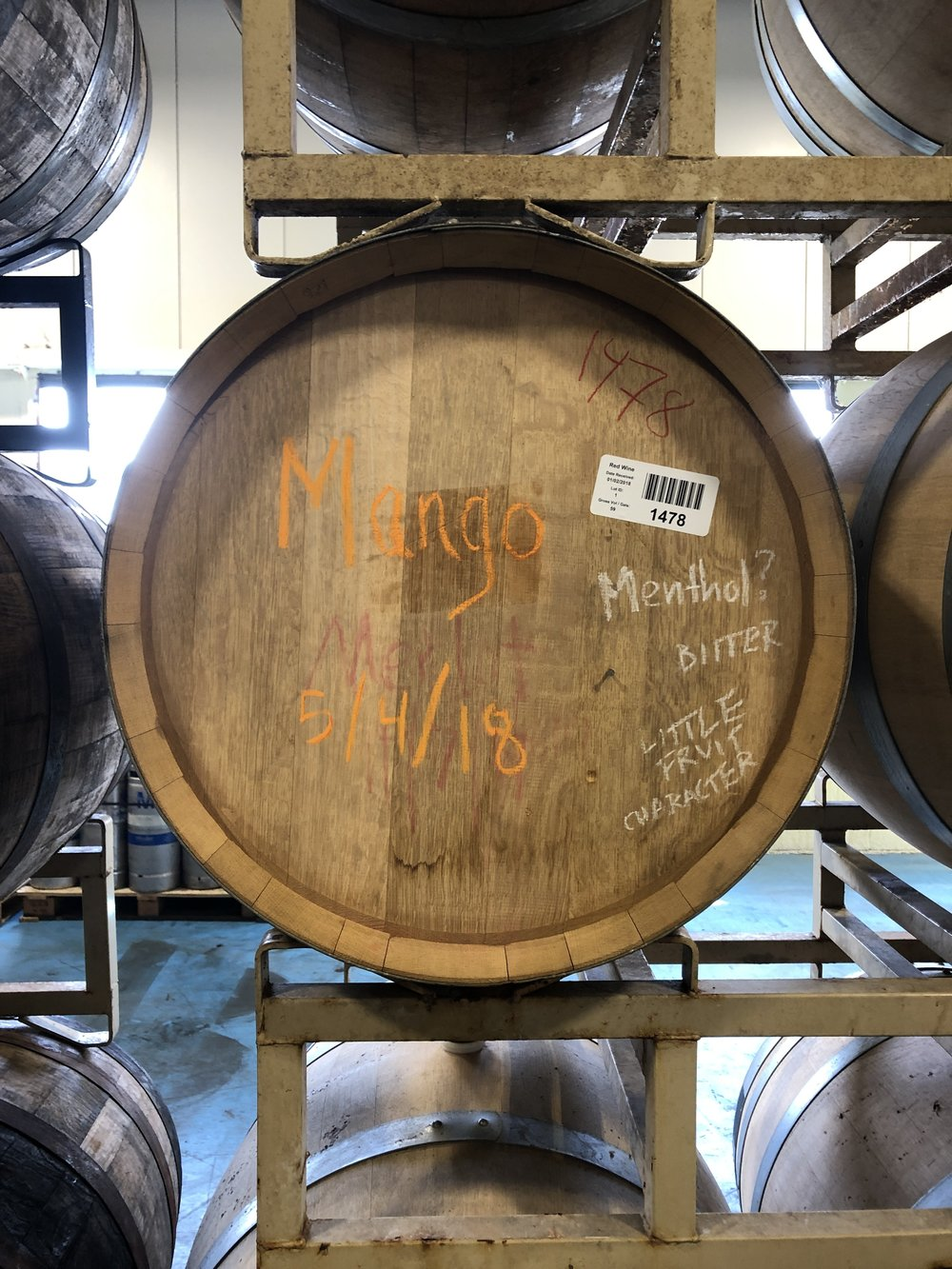 Tasting notes are written in chalk, right on the barrel. -