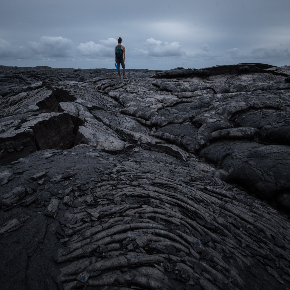 Traversing lava fields in Volcanoes National Park. Photo by Peter Constantinople.