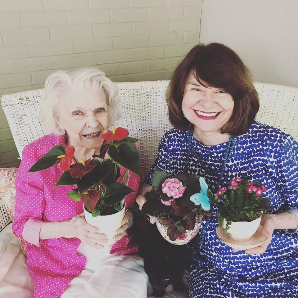 My mom and my grandmother with their flowers and teacups. I love that color blue that my mom is wearing. Come to think of it, they're both sort of dressed like flowers.