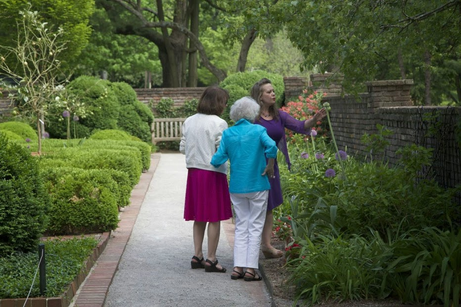 My mother, my grandmother, and me talking to a flower a couple of years ago.