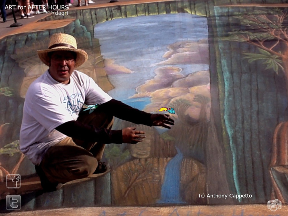 Through the app, the animated AR can be seen in the form of fluttering butterflies and a hummingbird...  Pictured Anthony Cappetto, designing and lead artist for 'Visions of Cambodia', the first public art display of 3D chalk art and 4D emerging technologies (augmented reality).