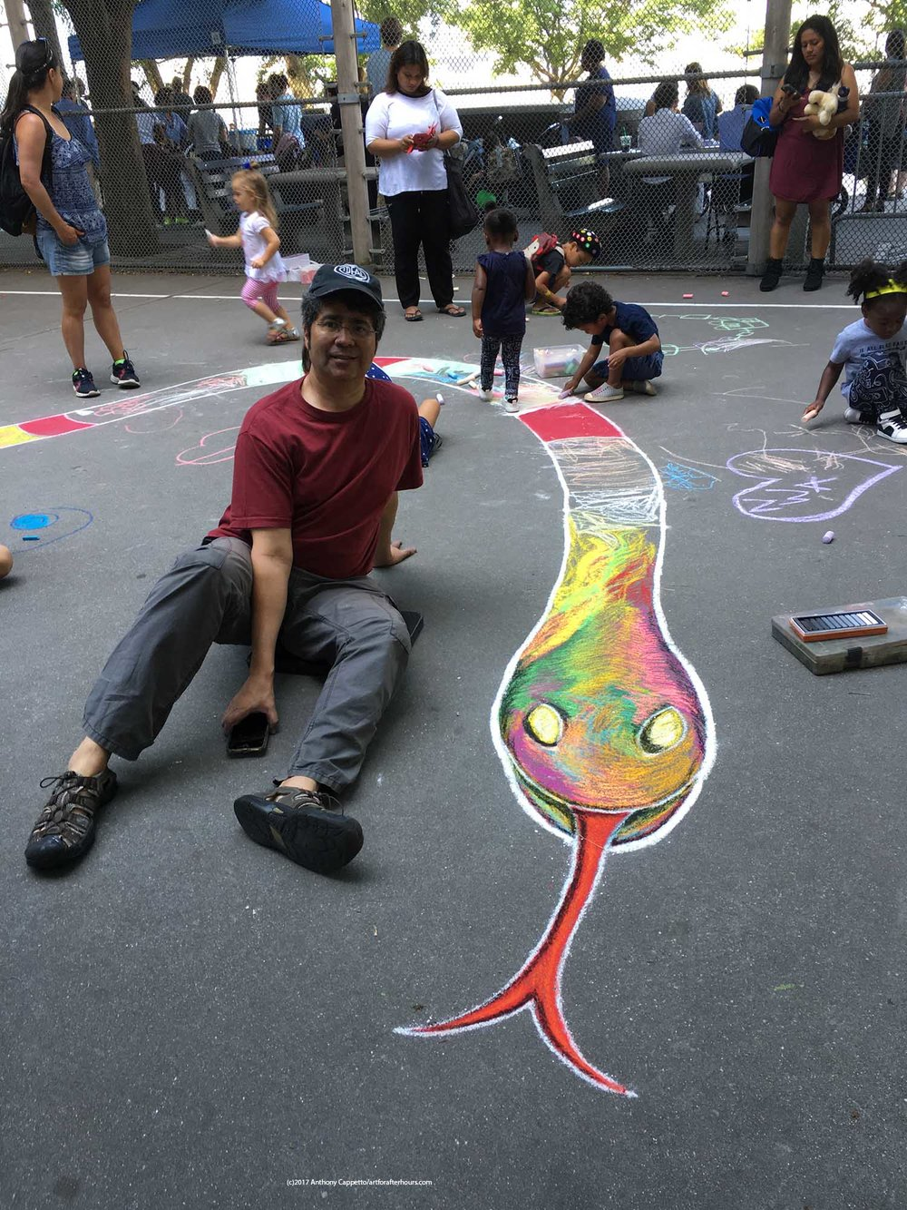 Anthony Cappetto posing for a picture with the head of the snake just before the kids descended upon the pavement which of course was the purpose of the pavement portion for this project!