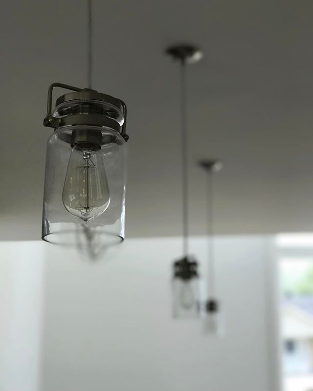 Simple, but elegant lighting over a kitchen island in one of the homes we recently completed. ▫️▫️▫️ Follow us on Pinterest (BILDdevelopment) for home inspiration and tips.
