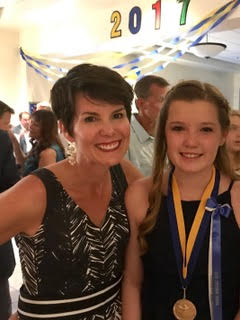 The author and her daughter, Josie, at 8th grade graduation.