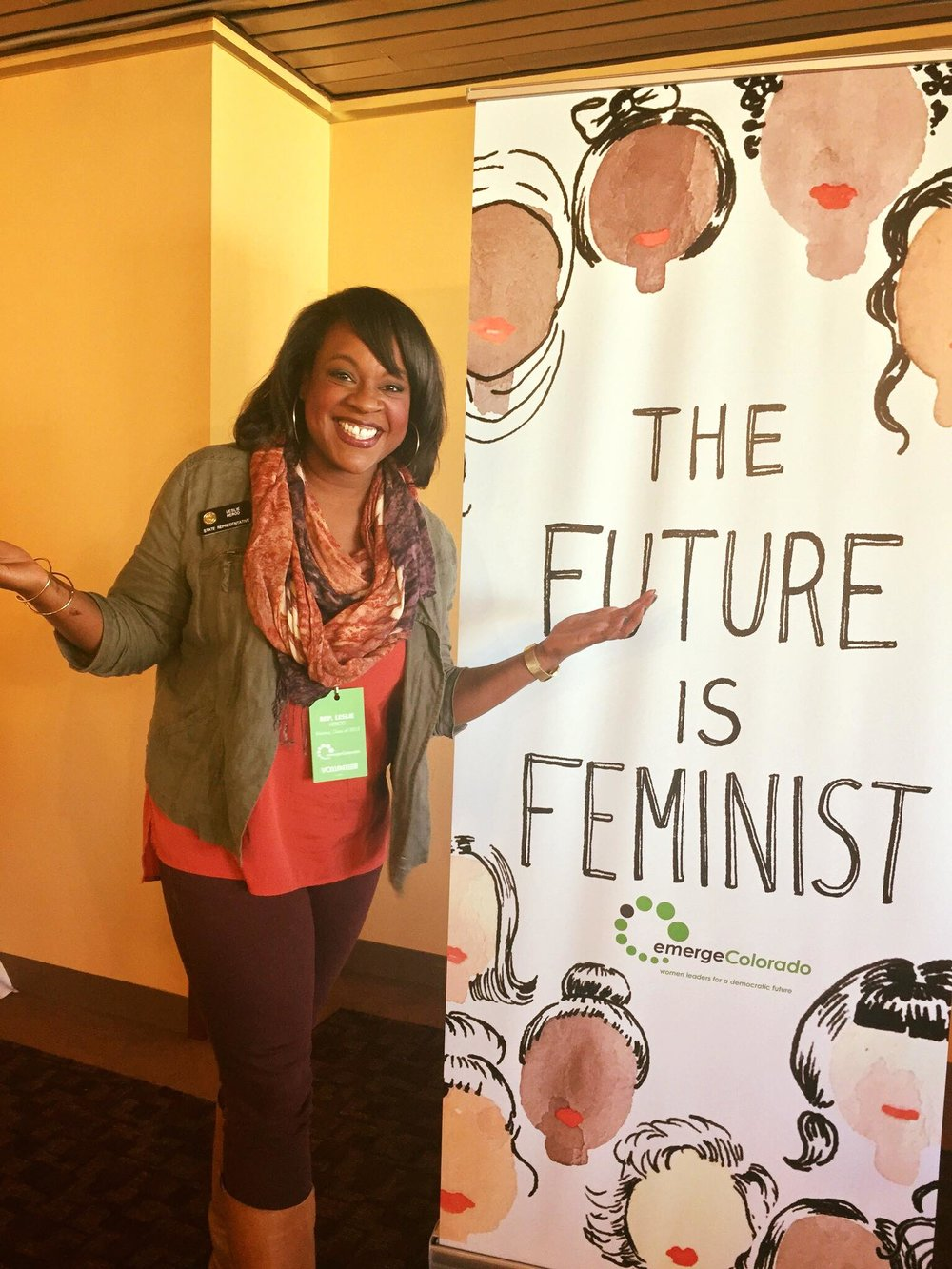 Herod, at an Emerge Colorado event, next to the art of Kimothy Joy. Photo from social media.
