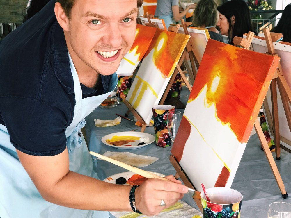 Man smiling with his painting