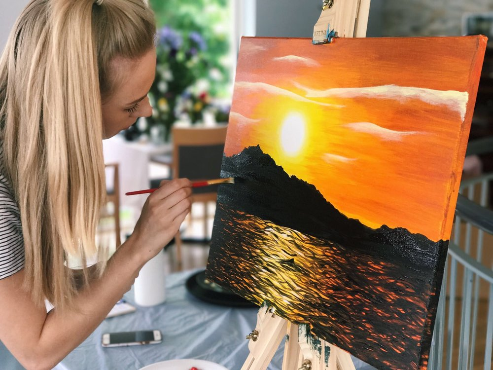 Anna painting her sunset picture