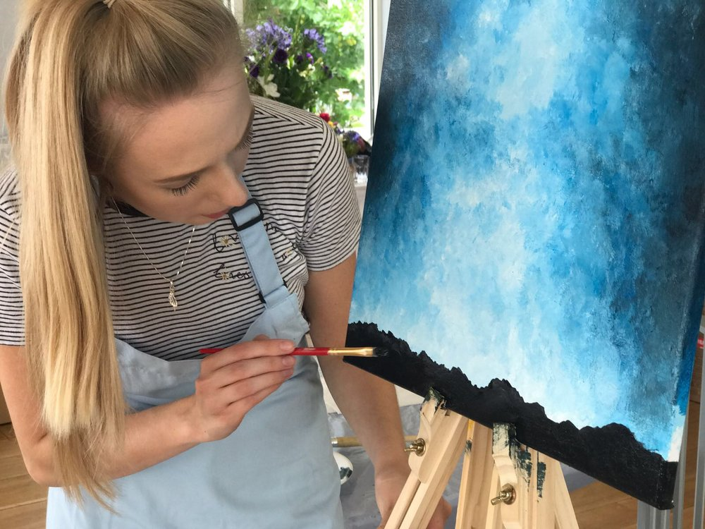Anna with her tree painting