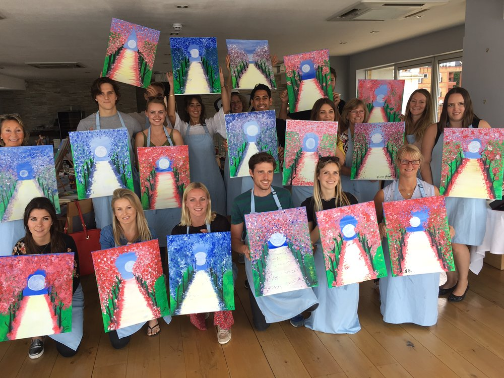 Group photo of the finished paintings - class one