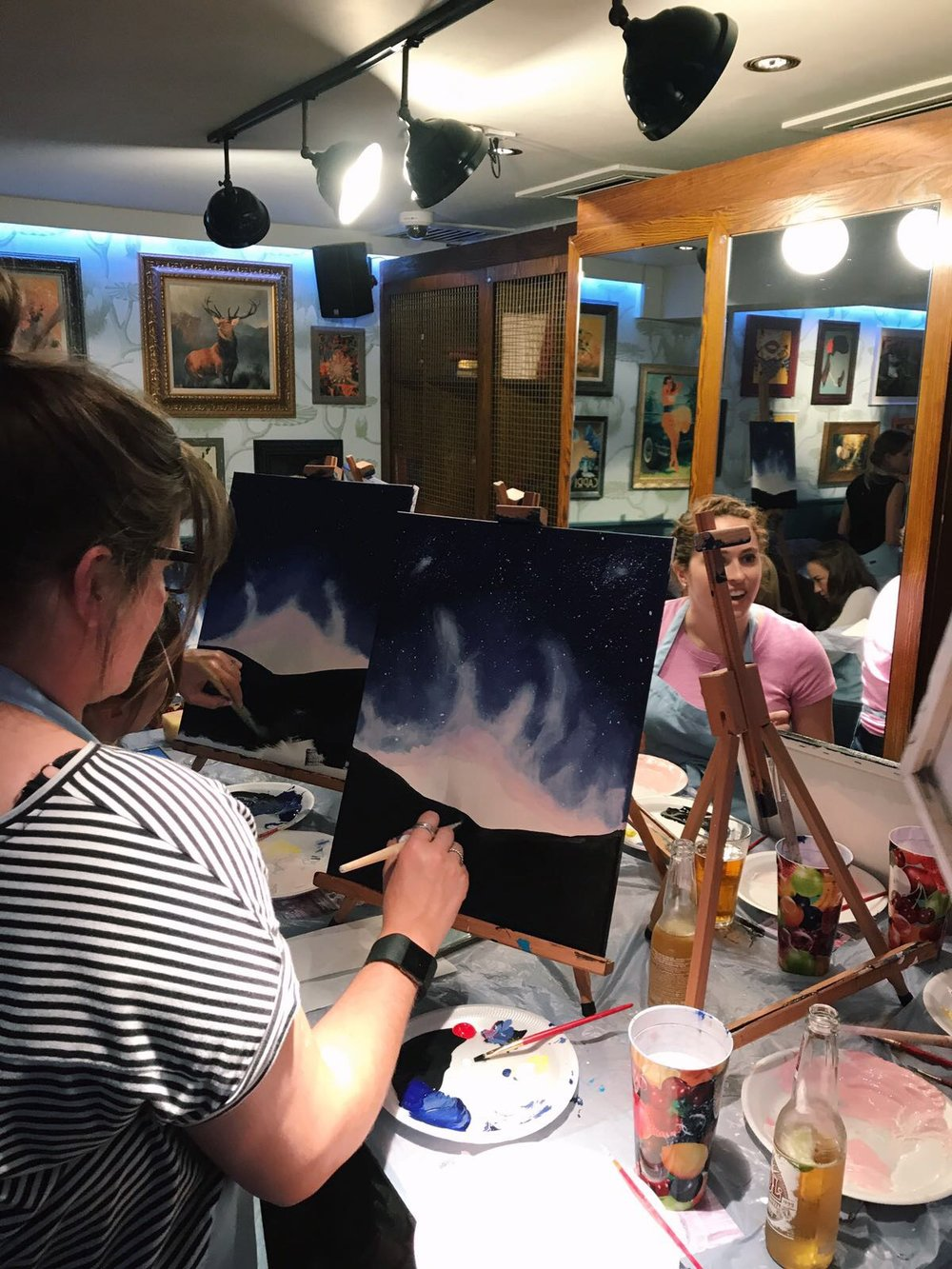 Getting involved with painting all edges of the canvas!