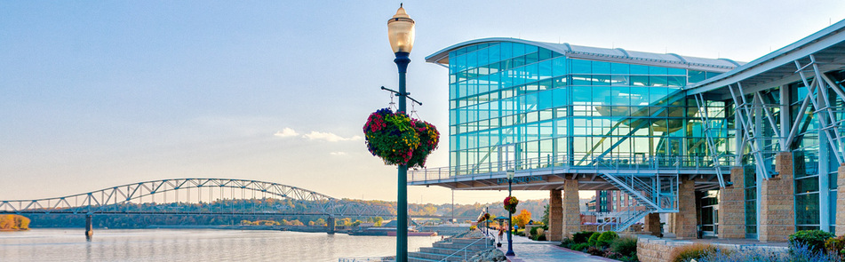 The festival takes place at the Grand River Center in Dubuque, situated on the Mississippi River. Lodging is available at the Grand Harbor Hotel and other places close by.