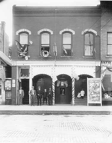 John Runk Studio above 112 North Main Street. Downstairs, there was a theater as shown in this photo.  Photo credit is John Runk, courtesy of the Stillwater Public Library To go to this same view today, click or tap the photo above.