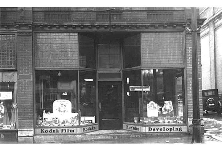 "John Runk Photography Shop located on Chestnut Street, just west of Main Street on the south side of Chestnut Street.  Ca. 1930's.  John was famous for the ""Square Deal"".  His logo always included the square deal motto.  Photo credit, Mr. John Runk, courtesy of Stillwater Public Library. Click or tap the photo above to view the same location today."