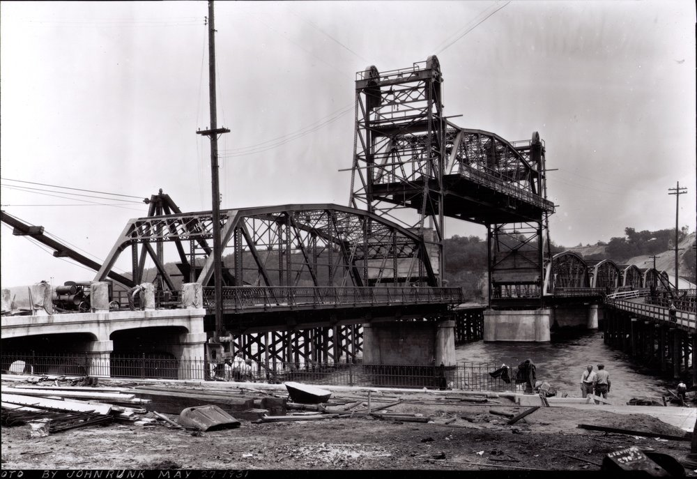 Lift Bridge Under Construction, 1931.  Photo credit, Mr. John Runk, courtesy of Stillwater Public Library. CLICK OR TAP THIS TEXT TO SEE GOOGLE MAPS 360 STREET VIEW OF THIS SAME LOCATION IN 2016.