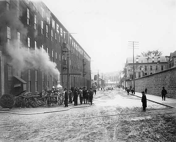 Fire at Northwest Thresher Company in 1909. The view is south on Main Street between the prison and the factory. Photo credit, Mr. John Runk, courtesy of the Stillwater Public Library.