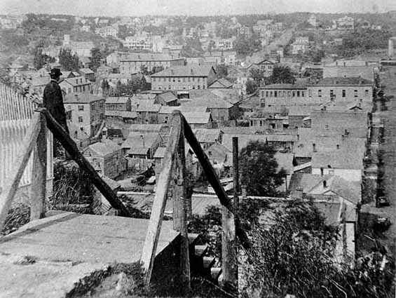 This is a photo from 1873 taken by Christopher Carli, who was a photographer who came before John Runk. He took photos of Stillwater and used many in stereo photo scenes. The gentleman in this photo is James Sinclair, another photographer in Stillwater.