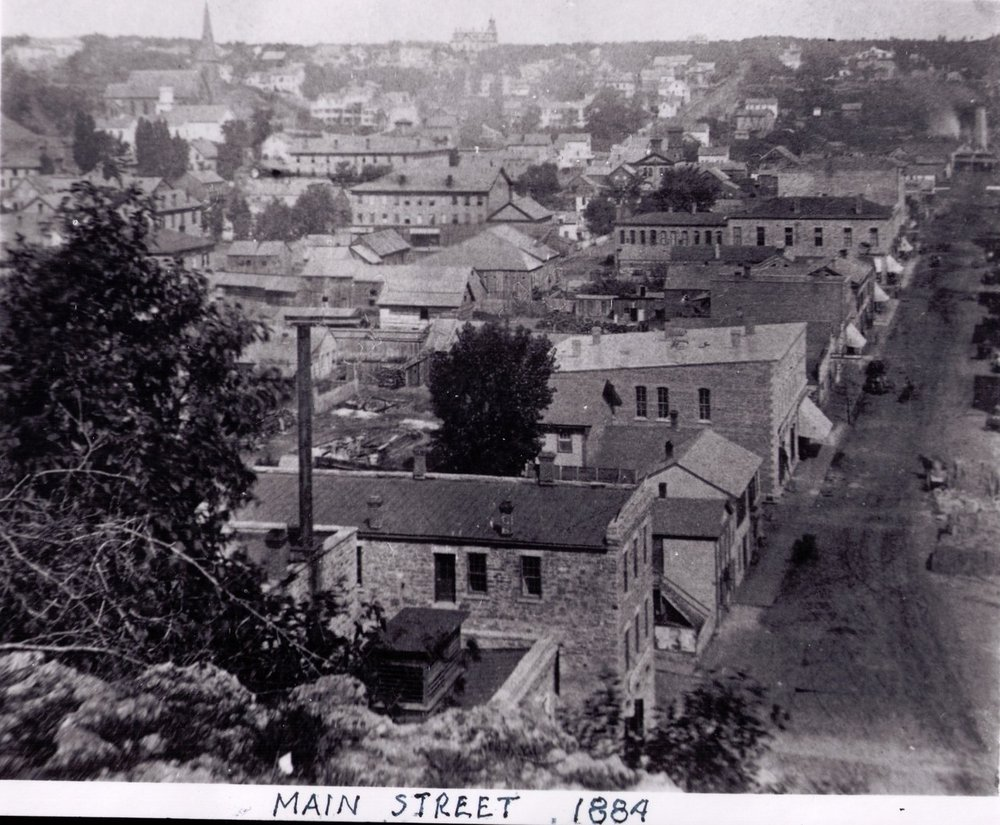 This photo was taken in 1884. It is from the Runk Collection, courtesy of the Stillwater Public Library. You can see the Lincoln School above the horizon on the north hill. This also is a north view from the top of the south hill stairway.