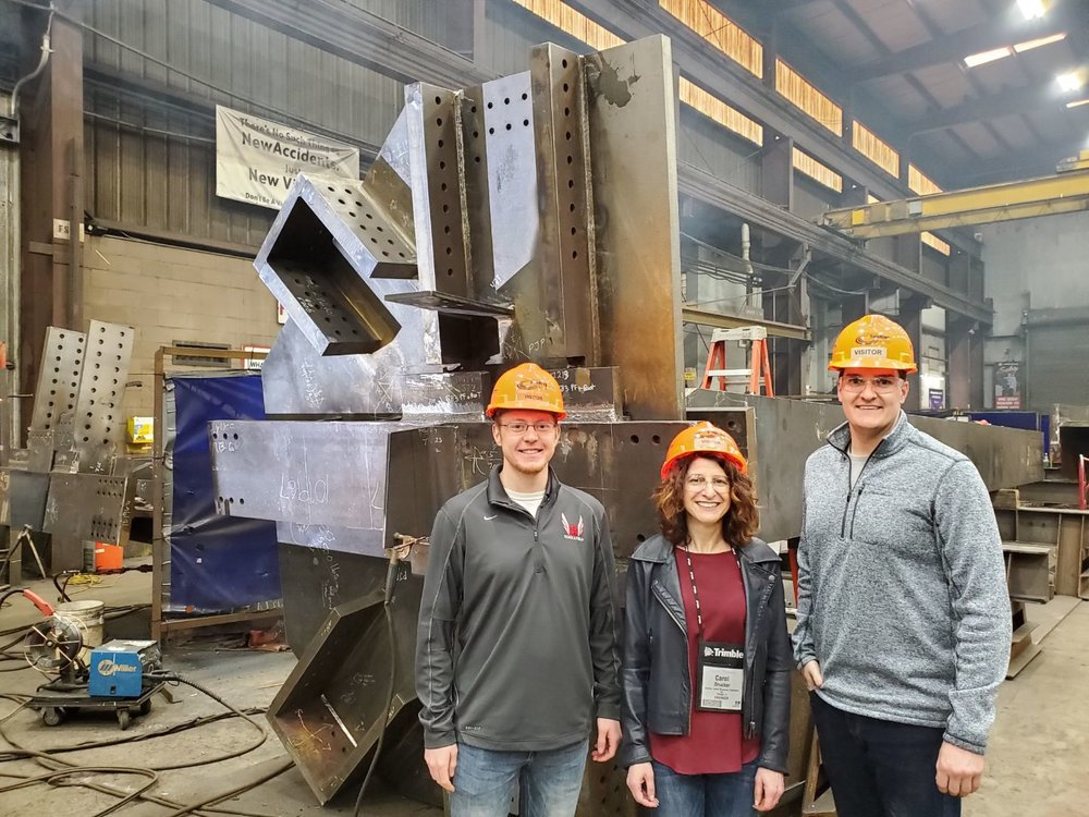 Logan Bertling, Carol Drucker, Michael Herriges visit the shop where the outrigger and belt trusses are being fabricated for the 110 N Wacker project in Chicago. The connections are designed by DZSE.
