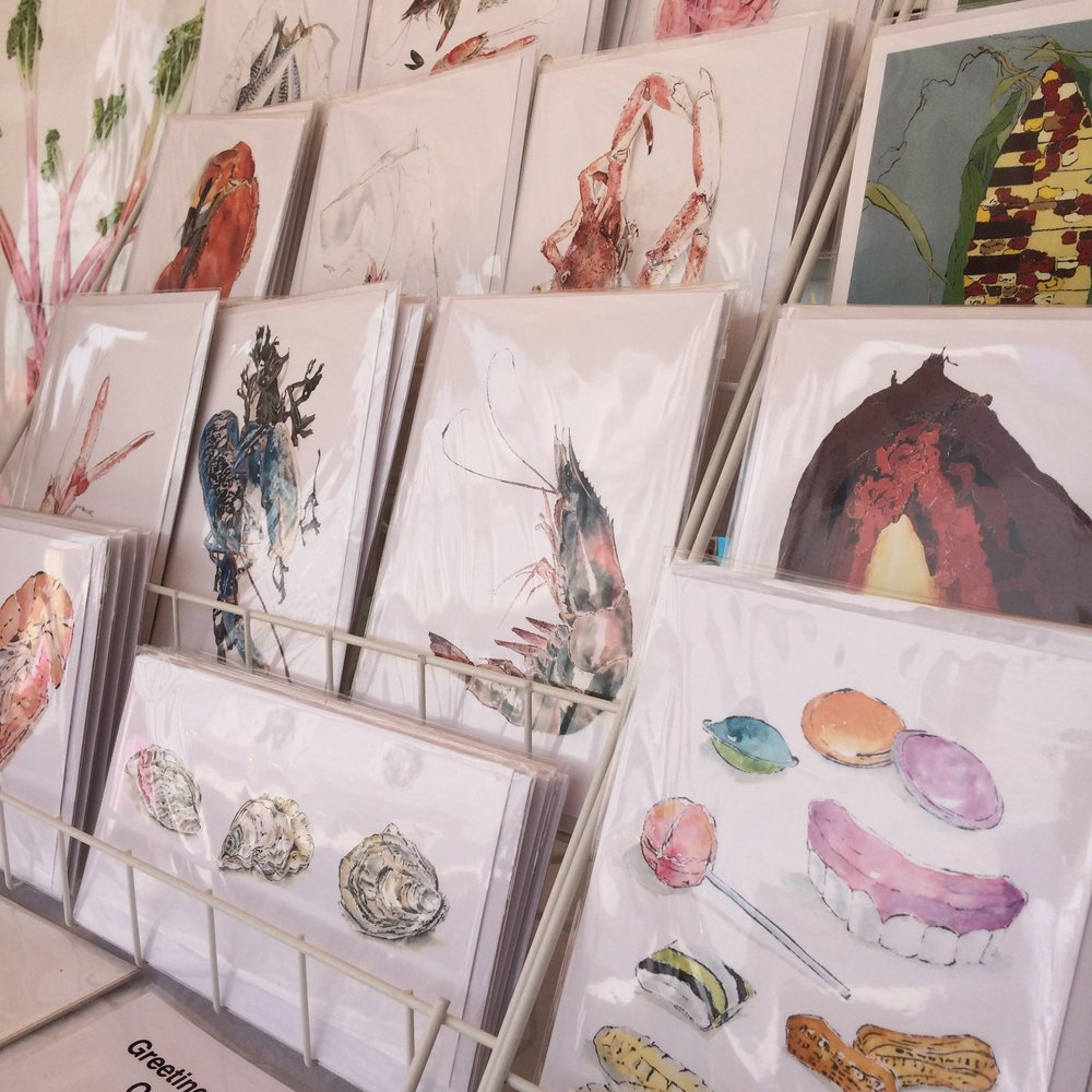 Greetings cards of original paintings by Lucy Clayton at The Pantiles Christmas Market, Tunbridge Wells, Kent.