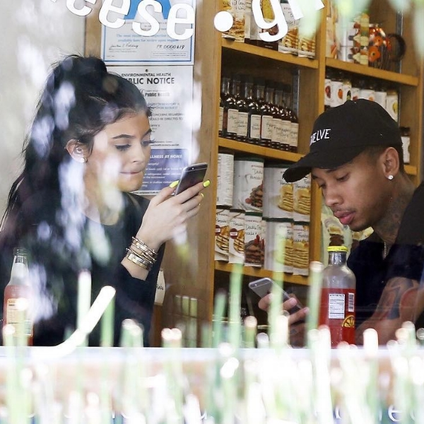 Kylie and Tyga sit window-side as they await their meal