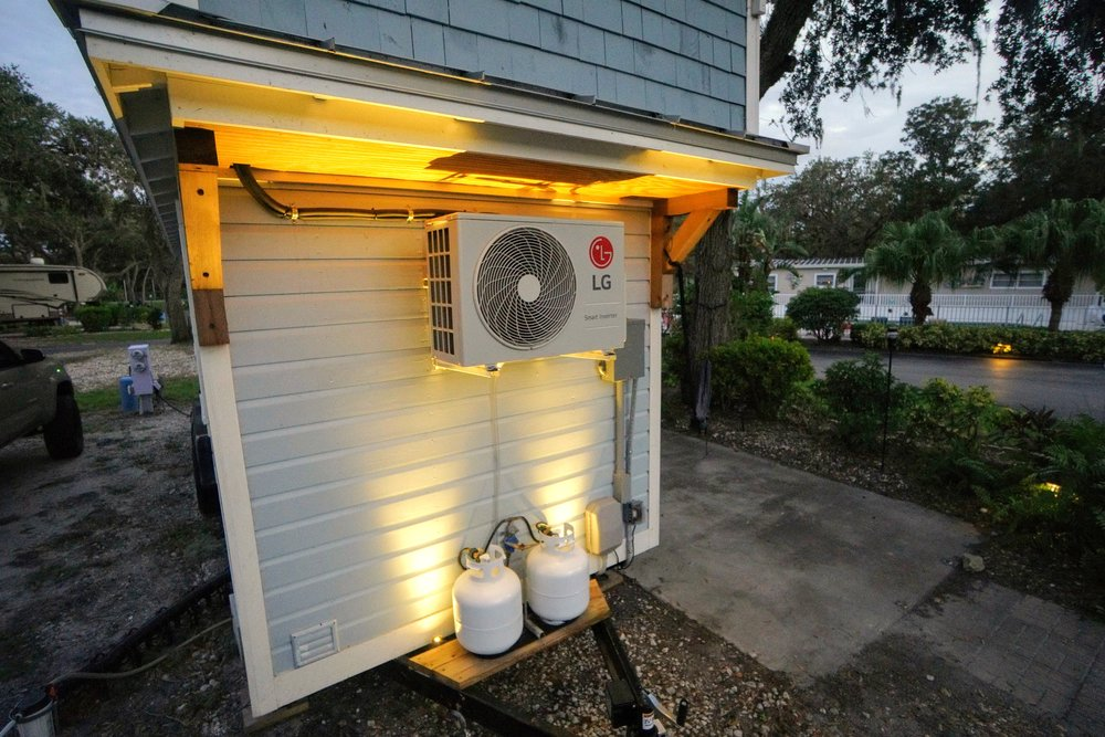 Tiny home living outdoor landscape lighting install kichler 100w dc transformer VLO fixture tree mount mobile lighting hotspots propane gauge landscape lighting design outdoor living space