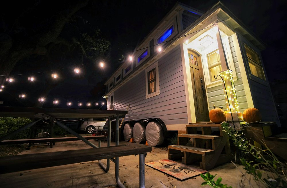Tiny house on wheels utilities propane gas  smart refrigerator outdoor string lights