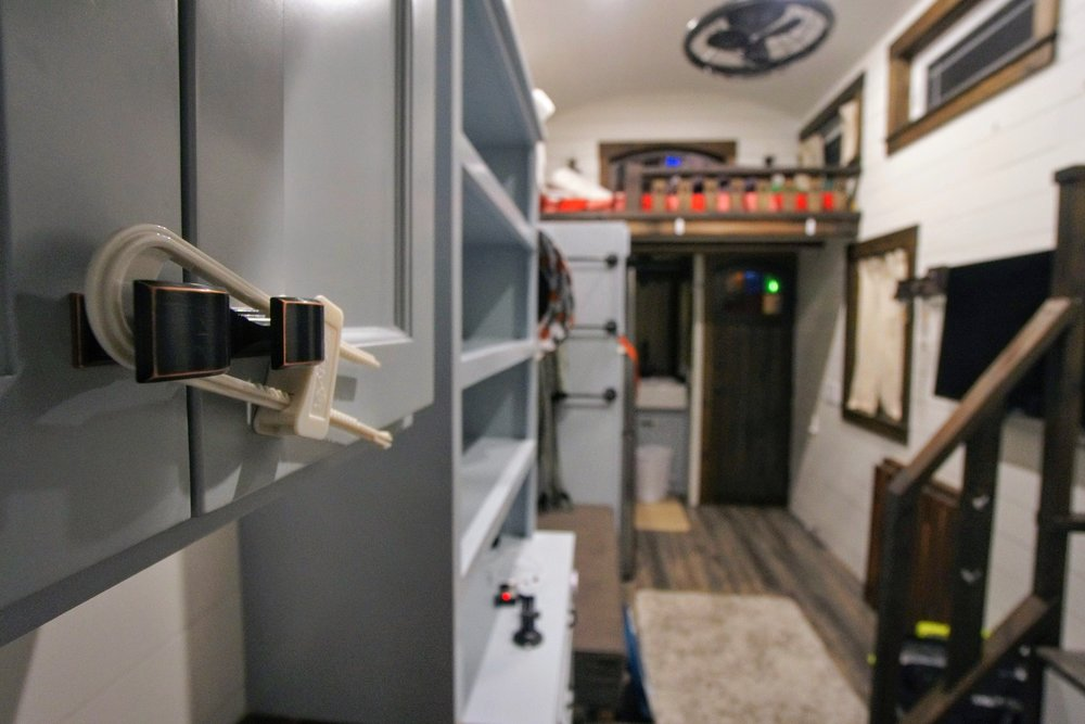 Moving a tiny home straps fridge child-lock cabinet