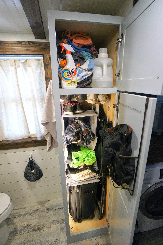 Tiny home organization closet space shoes bathroom tub shower clothes