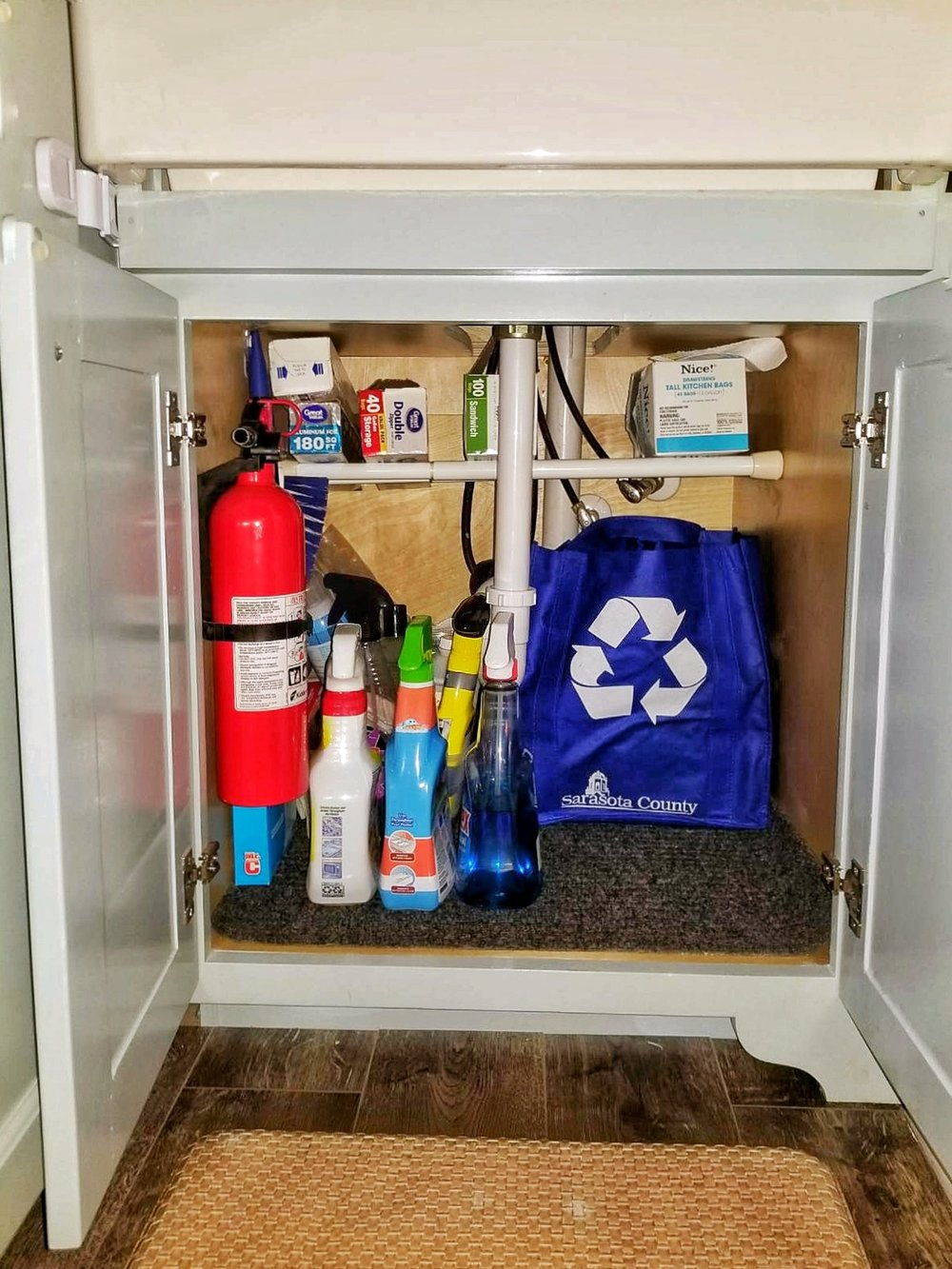 Tiny home organization closet space shoes bathroom tub shower clothes tiny house under sink organization