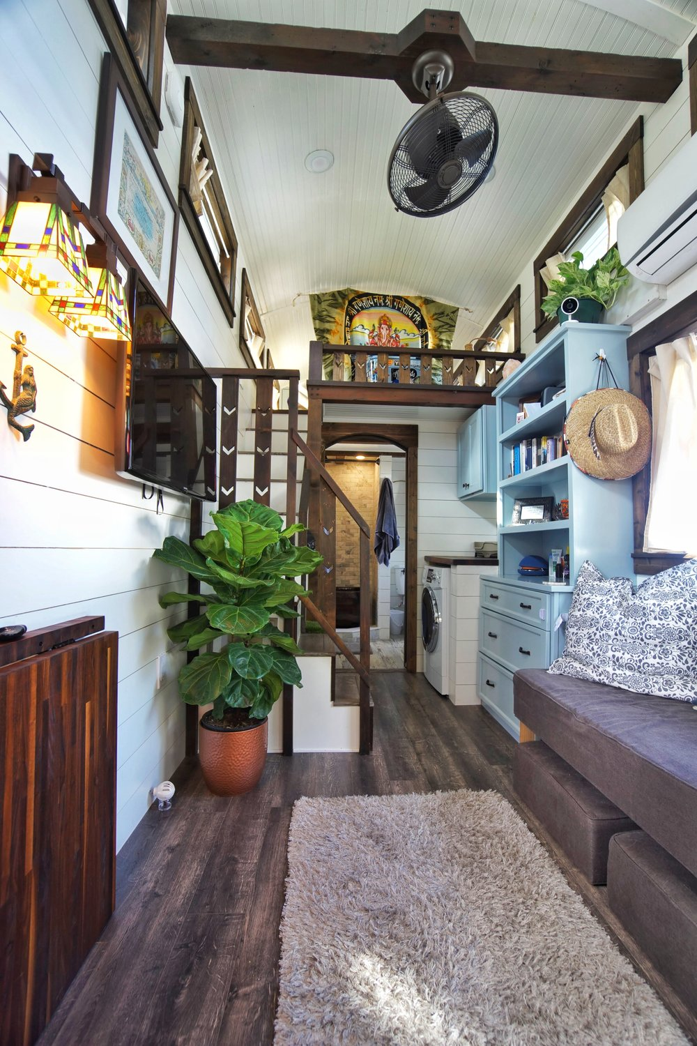 Tiny House tiny living fiddle leaf fig tree never stop exploring lg tiny house on wheels small living fan fantastic nest wall sconces washer dryer combo lg tv straw hat