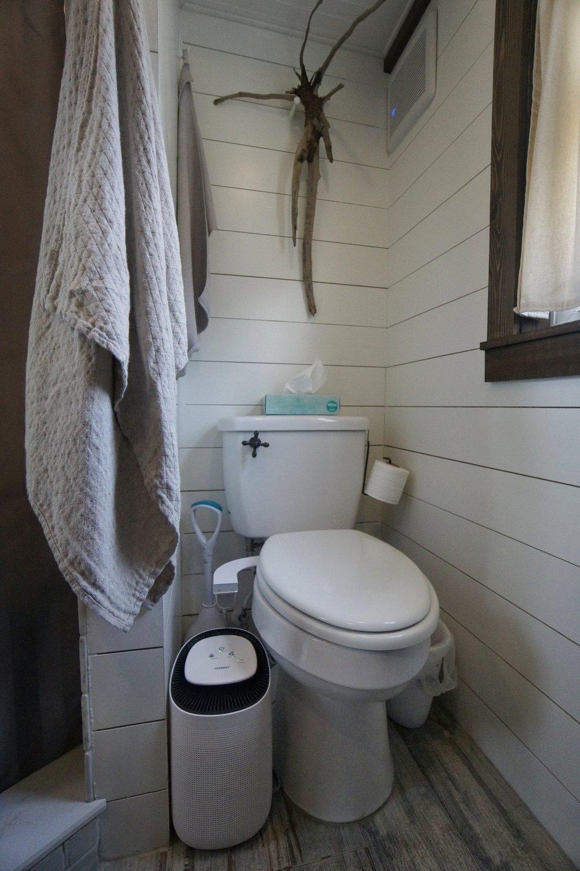 Tiny house tiny home tiny house on wheels live tiny bathroom dehumidifer linen towels exhaust fan
