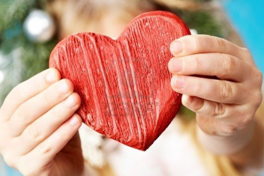 9360310-close-up-of-red-wooden-heart-in-child-s-hands-showing-it.jpg